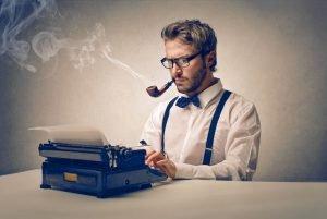 bigstock-handsome-journalist-writing-wi-43410031-600x402